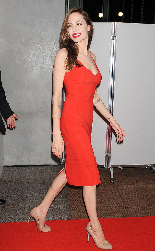 Angelina Jolie gave a big smile at the Moneyball premiere.