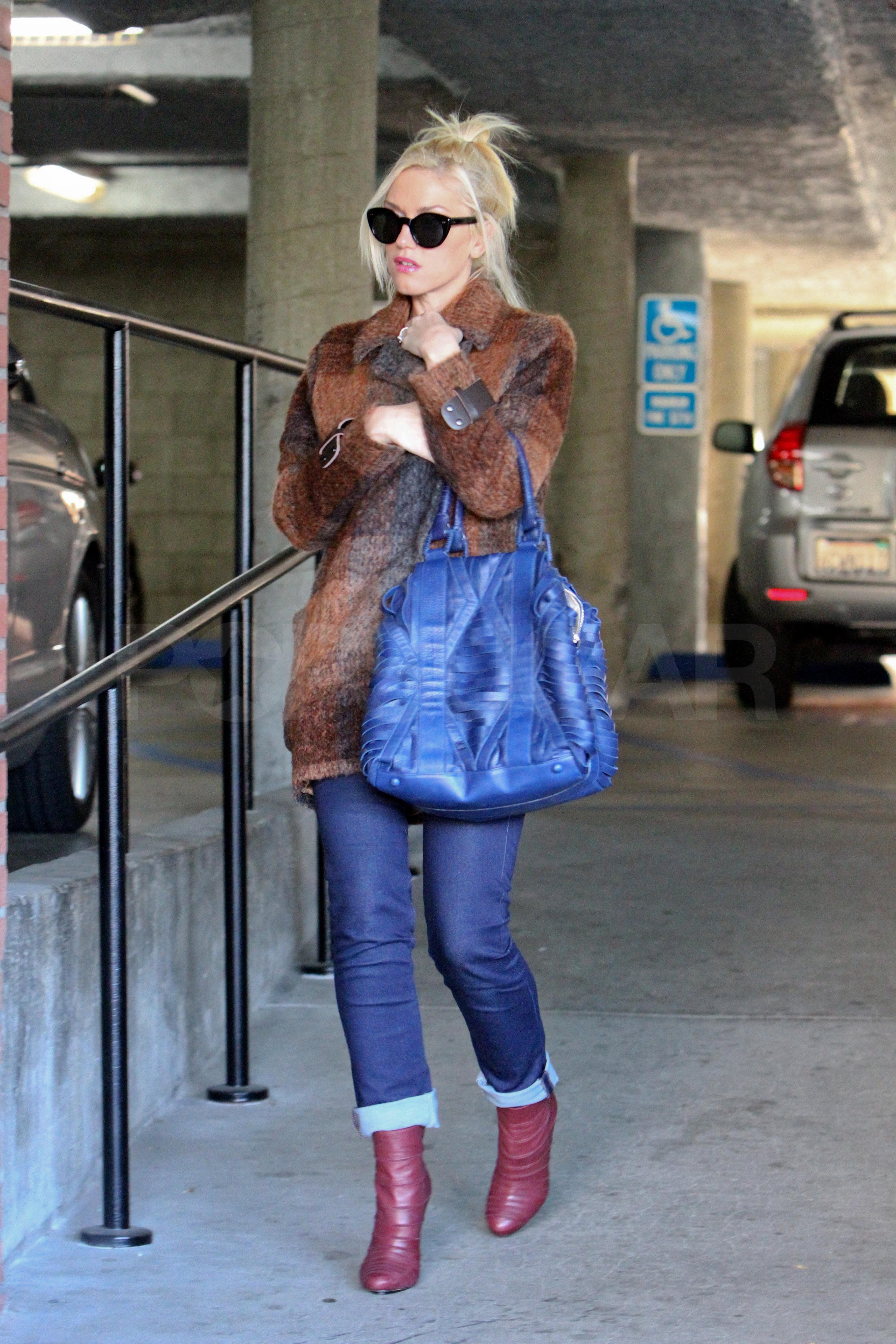 Gwen carried a bright blue bag to a meeting.