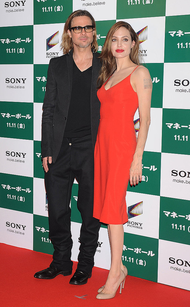 Brad Pitt and Angelina Jolie got close in Tokyo at the Moneyball premiere.