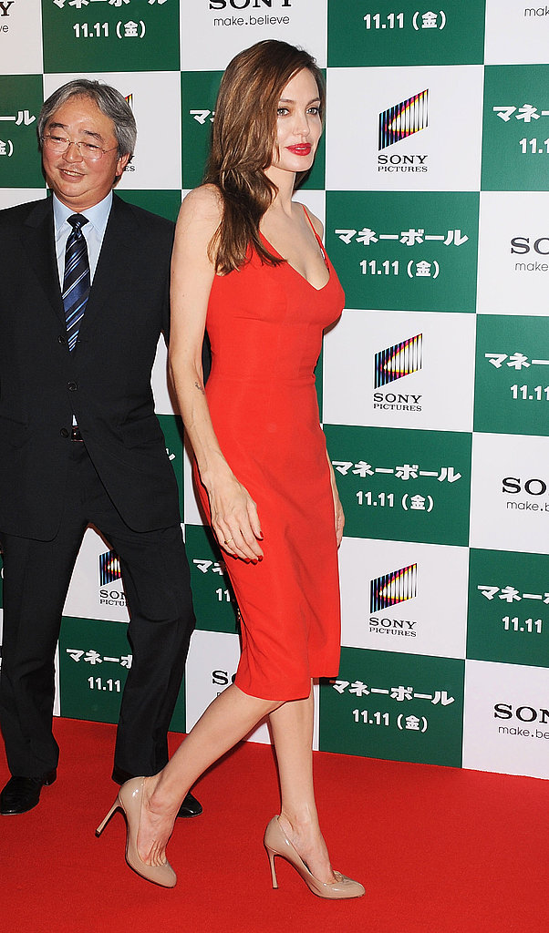 Angelina Jolie paired nude heels with a red dress.