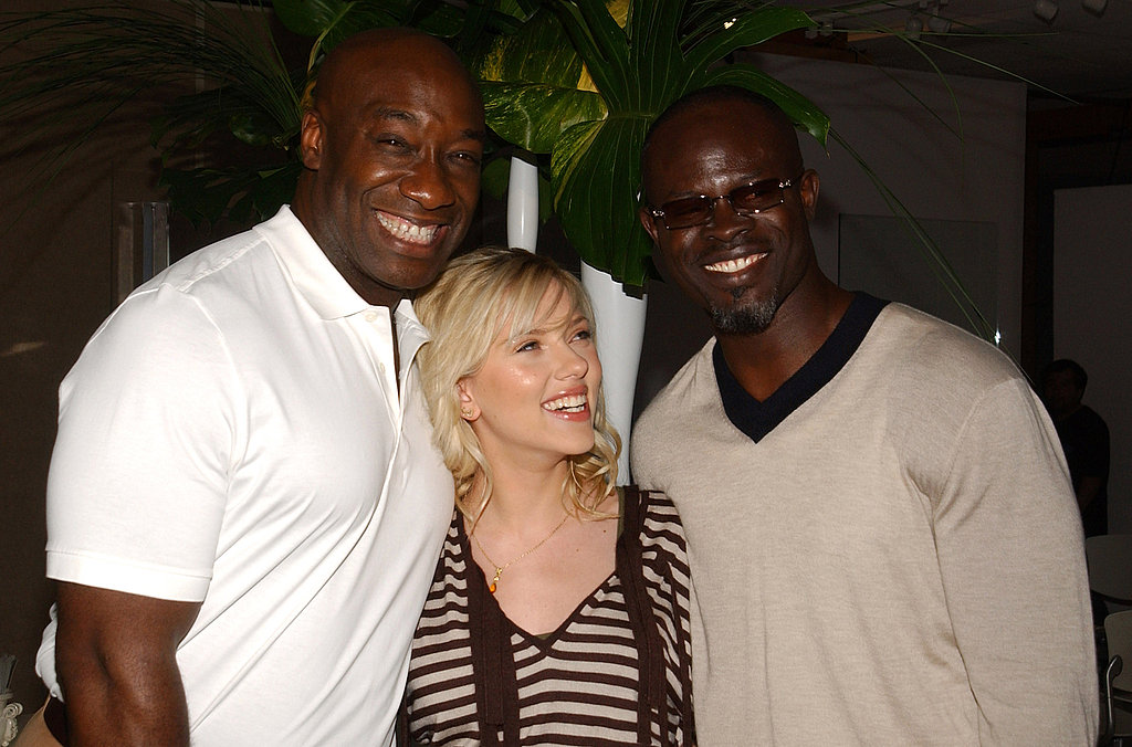 Scarlett smiled with her The Island costars Michael Clarke Duncan and Djimon Hounsou in 2005.