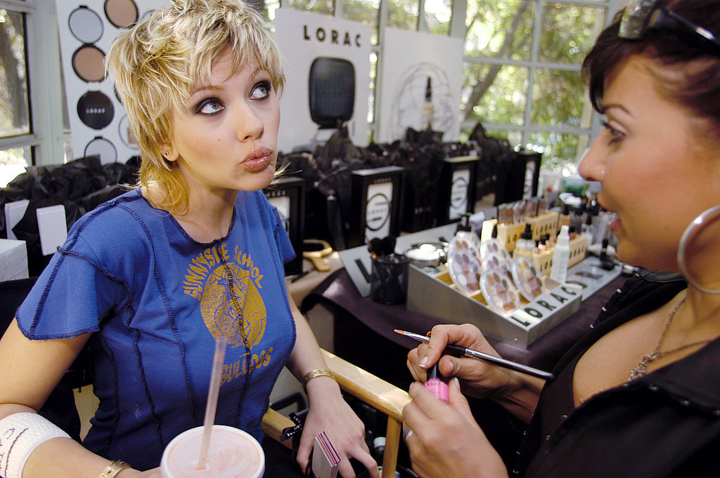 Scarlett struck a silly pose while getting her nails done at an event in 2003.