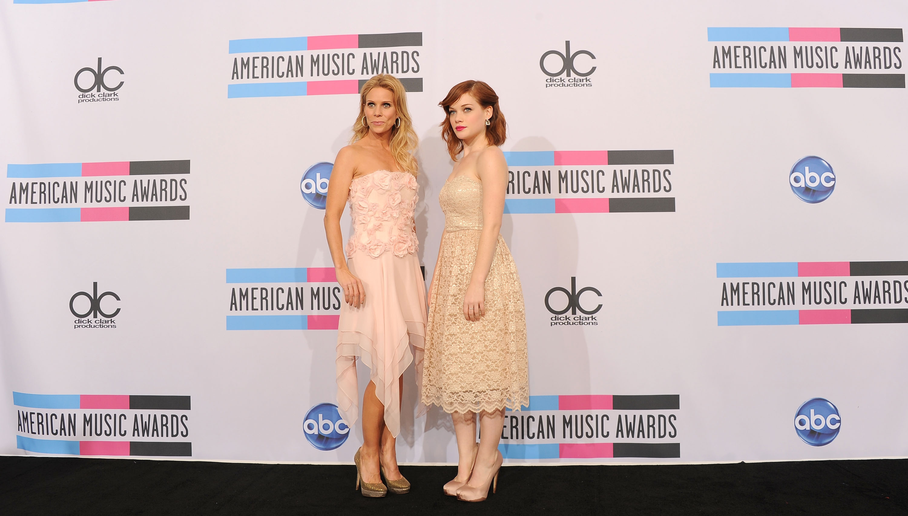 Cheryl Hines and Jane Levy ran into the press room at the American Music Awards.