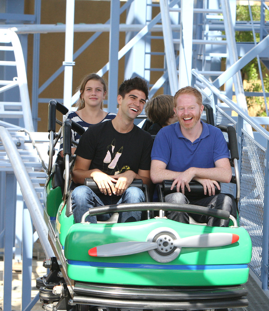 Jesse Tyler Ferguson and Justin Mikita hopped on a ride in July 2011.