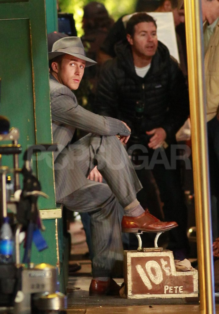 Ryan Gosling rested his foot on a shoe-shine pedestal.