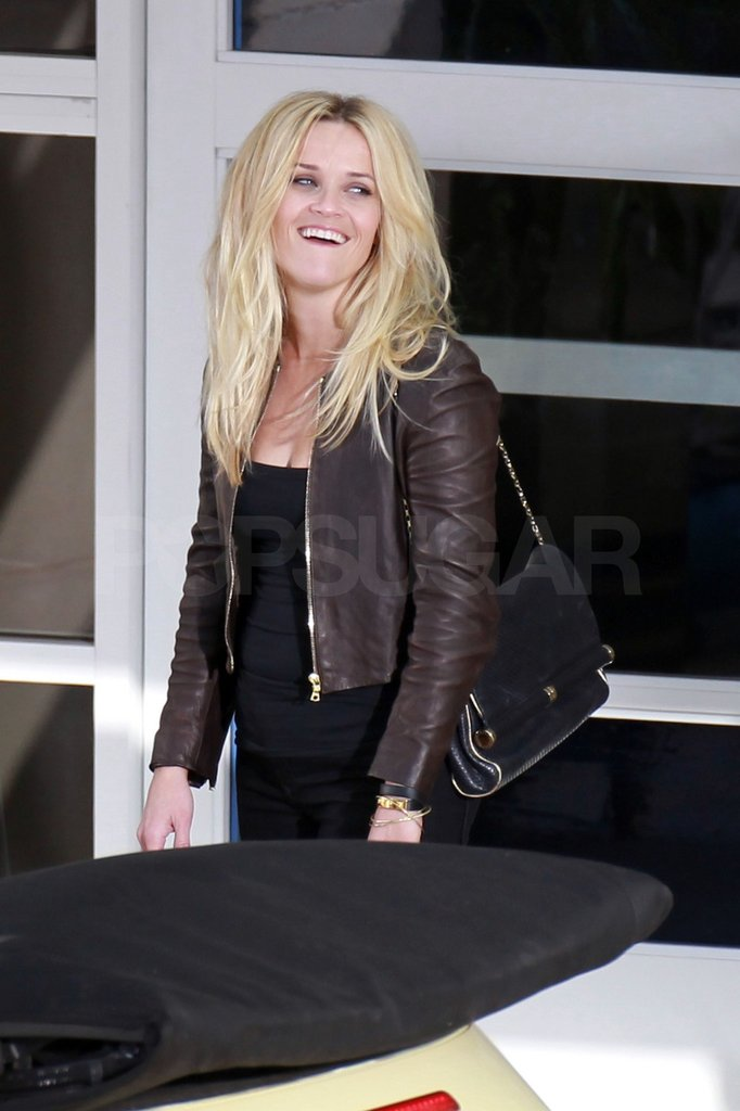 Reese Witherspoon sported wild hair on set.