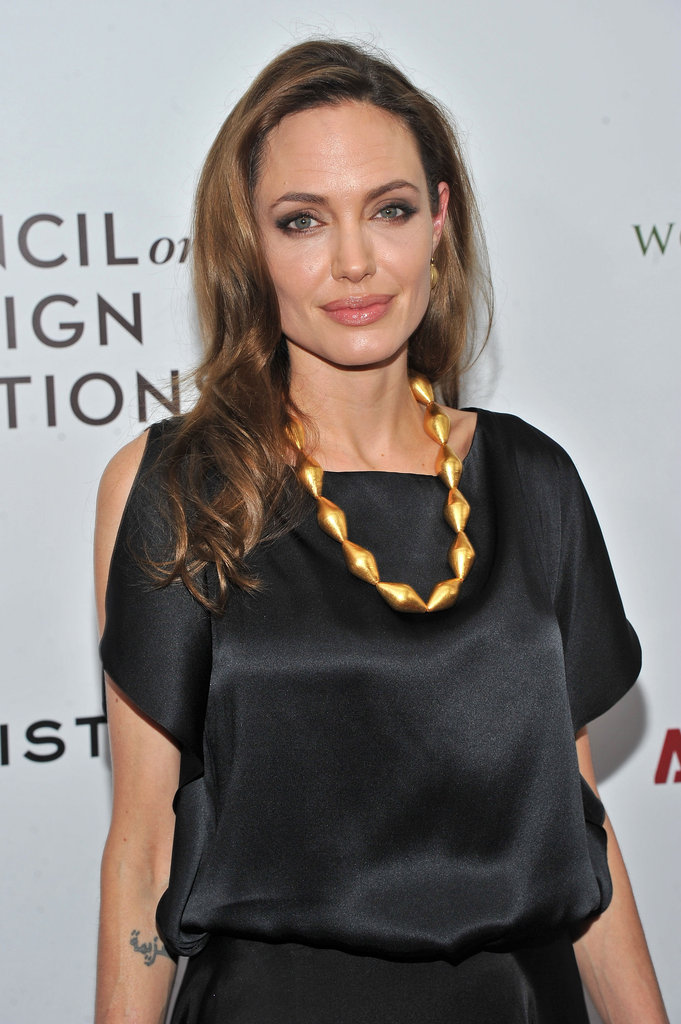 Angelina Jolie accessorized her look with a gold necklace.