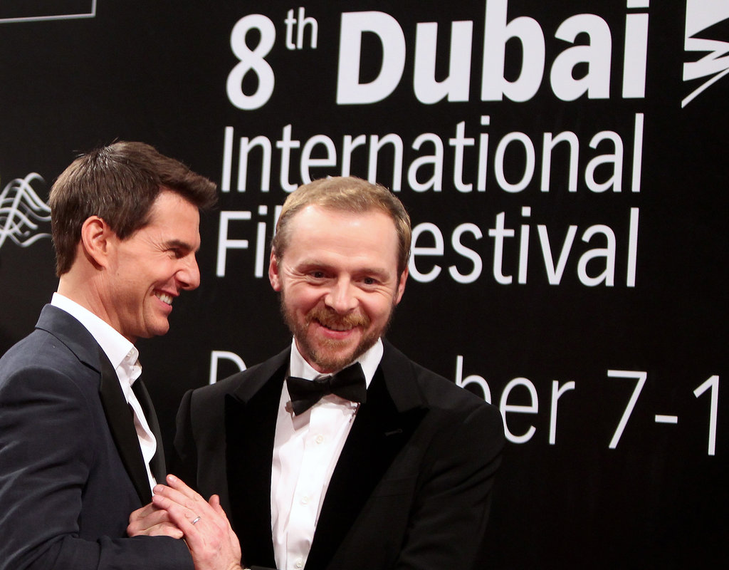 Tom Cruise and Simon Pegg fooled around on the red carpet.