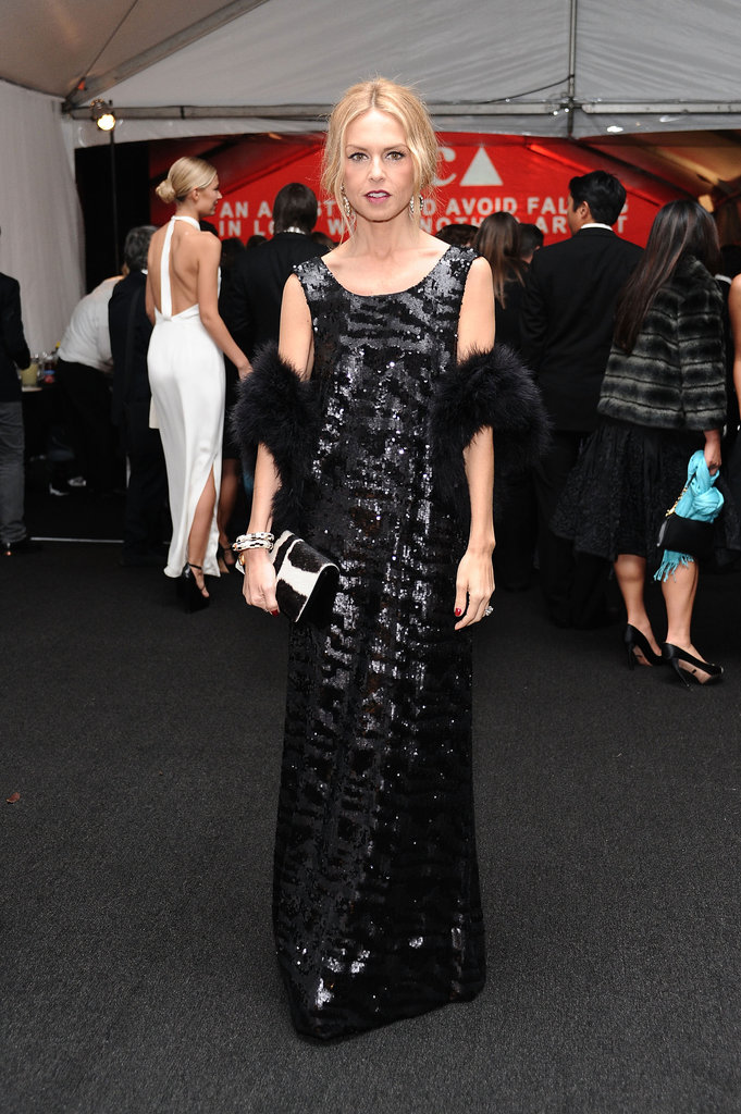 Rachel Zoe complements her shimmering gown with an equally glamorous fur stole.