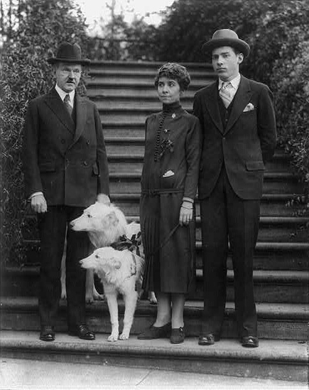 President Calvin Coolidge, first lady Grace, and two white Collies welcome son John home for the holidays. The Coolidges owned a full spectrum of pets including dogs, cats, birds, raccoons, a donkey, a bobcat, lion cubs, a wallaby, a bear, and a pygmy hippo. Source: Library of Congress