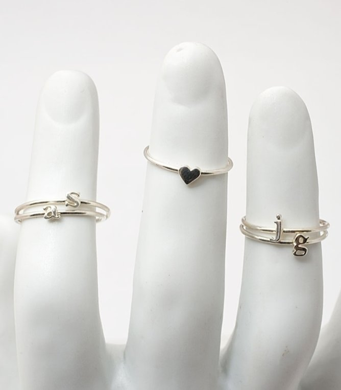"""I'm pretty sure I've outdone myself on the friendship bracelet front, so friendship rings it is. These delicate alphabet rings are from one of my favorite jewelry boutiques in Brooklyn. Customizing each ring with a friend's initials is the perfect way to keep a gift personal and super thoughtful."" — Marisa Tom, associate editor  Catbird Alphabet Rings ($52)"