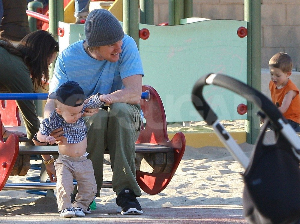 Playing with baby Robert brought a smile to Owen Wilson's face.
