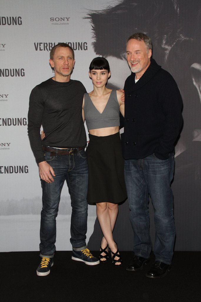 David Fincher was all smiles at a photocall with Rooney Mara and Daniel Craig.
