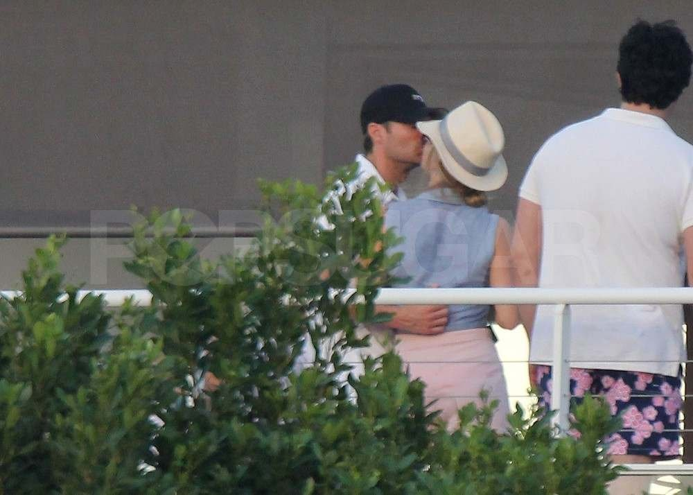 Ryan Seacrest and Julianne Hough kissing.