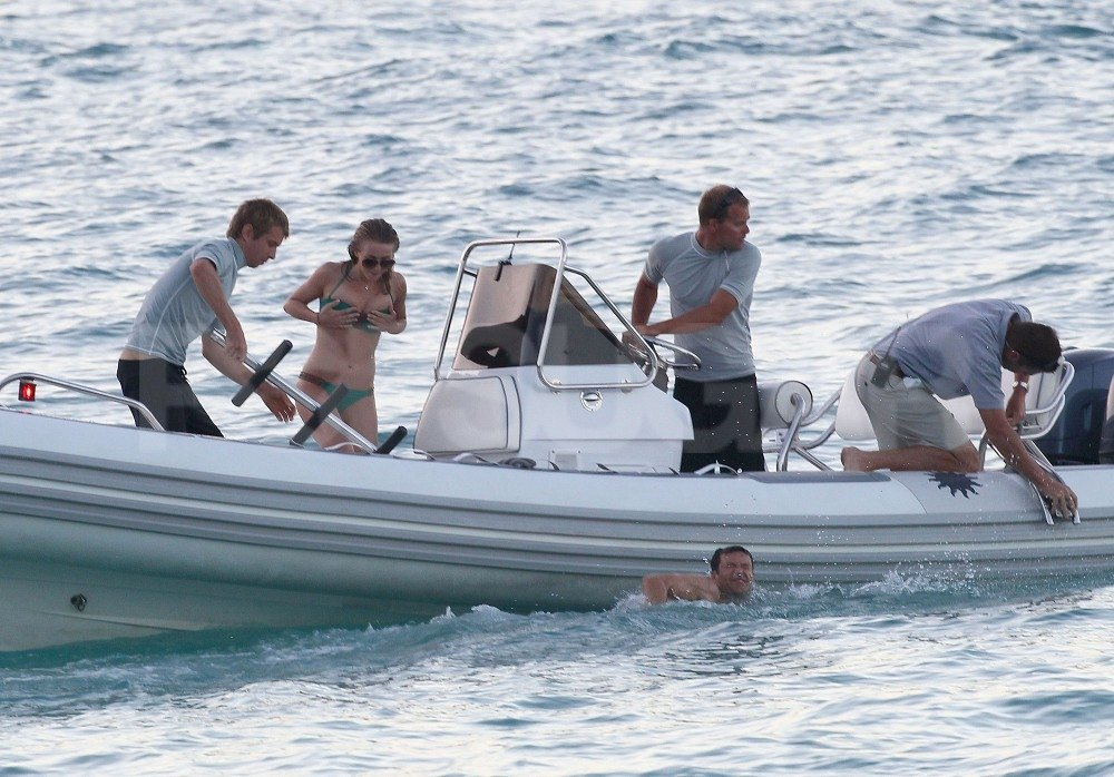 Julianne Hough was back in her bikini while Ryan Seacrest made his swim out to their boat.