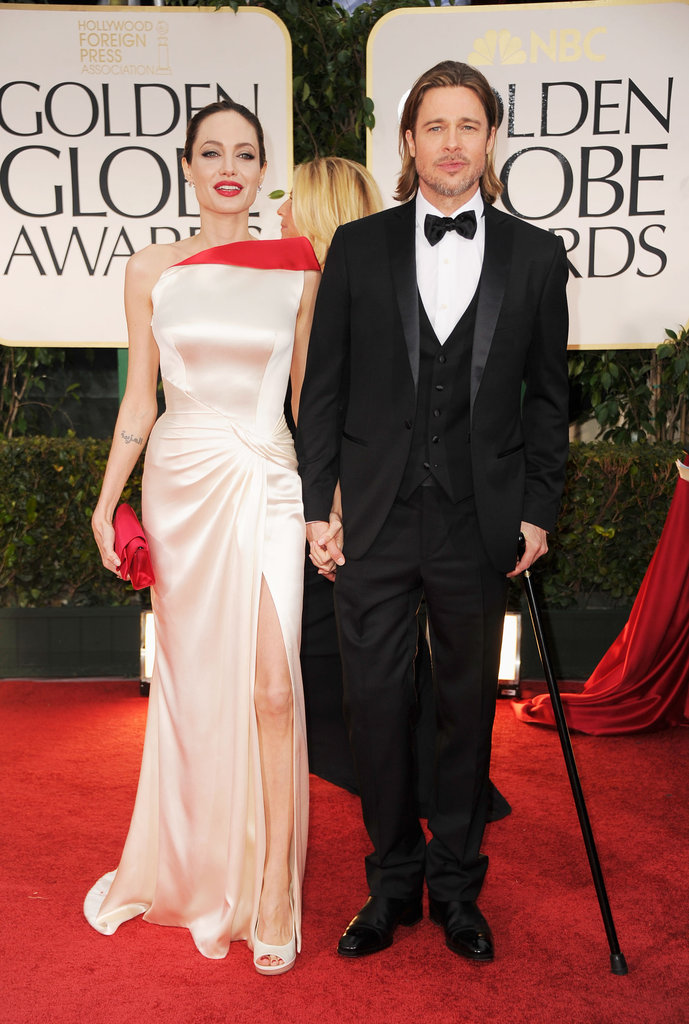 Angelina Jolie and Brad Pitt were smiling on the red carpet.