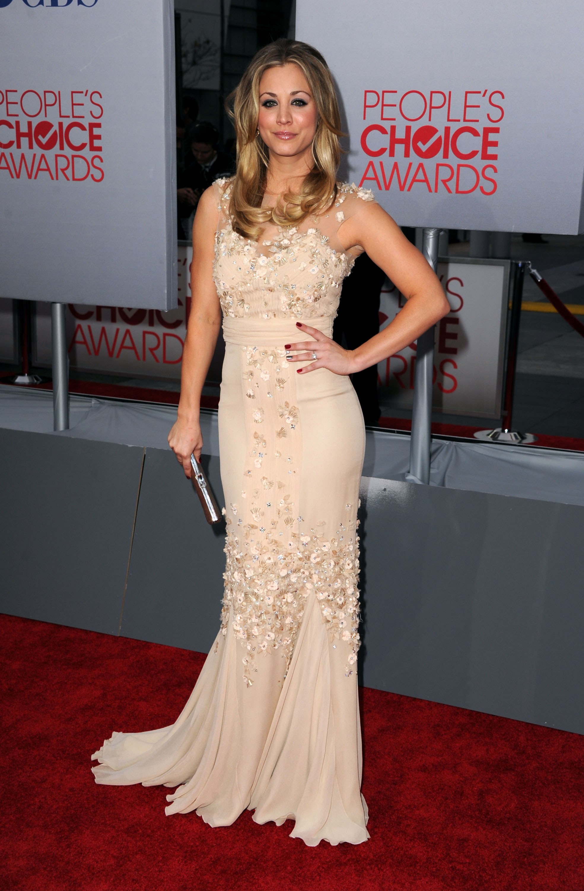 2012 People's Choice Awards host Kaley Cuoco on the red carpet .