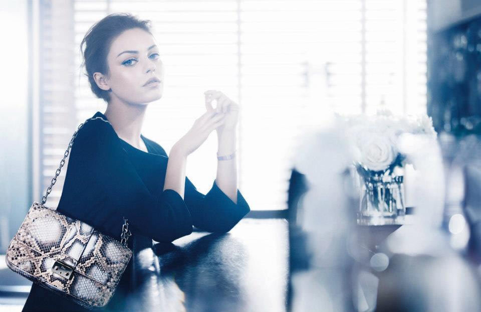 Mila Kunis models a stunning snakeskin Dior shoulder bag. Source: Fashion Gone Rogue