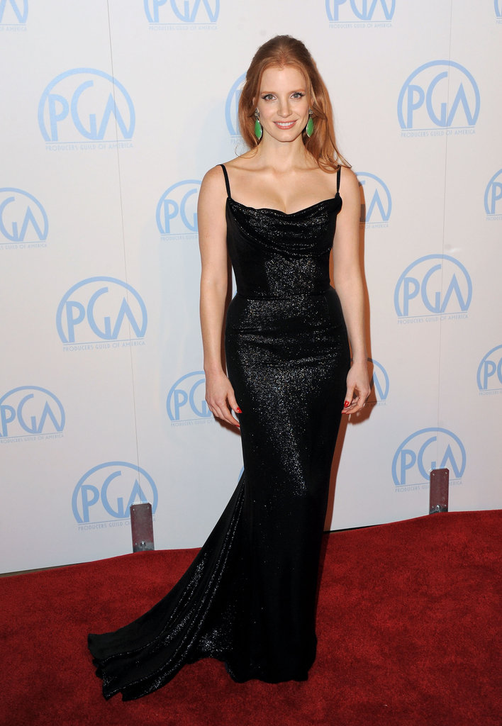 Jessica Chastain highlighted her custom shimmery Balenciaga gown with bold green drop earrings at the Producers Guild Awards.
