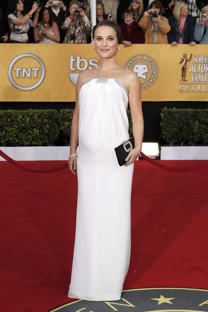 Natalie Portman showed off her growing belly in a pretty Azzaro gown last year.