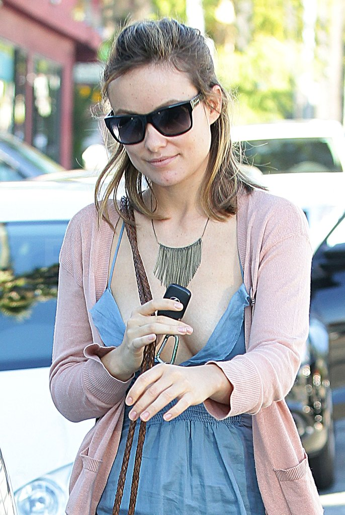 Olivia wore a bold statement necklace.