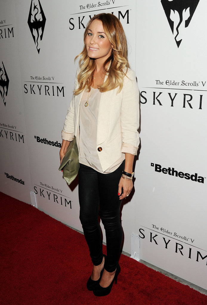 Signature LC style — skinny pants, loose tee, structured blazer and heels at the Skyrim launch party in November 2011.