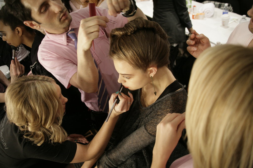 A model sits in the hair and makeup chair in a hurried rush before showtime. Photo: Megan Holmes