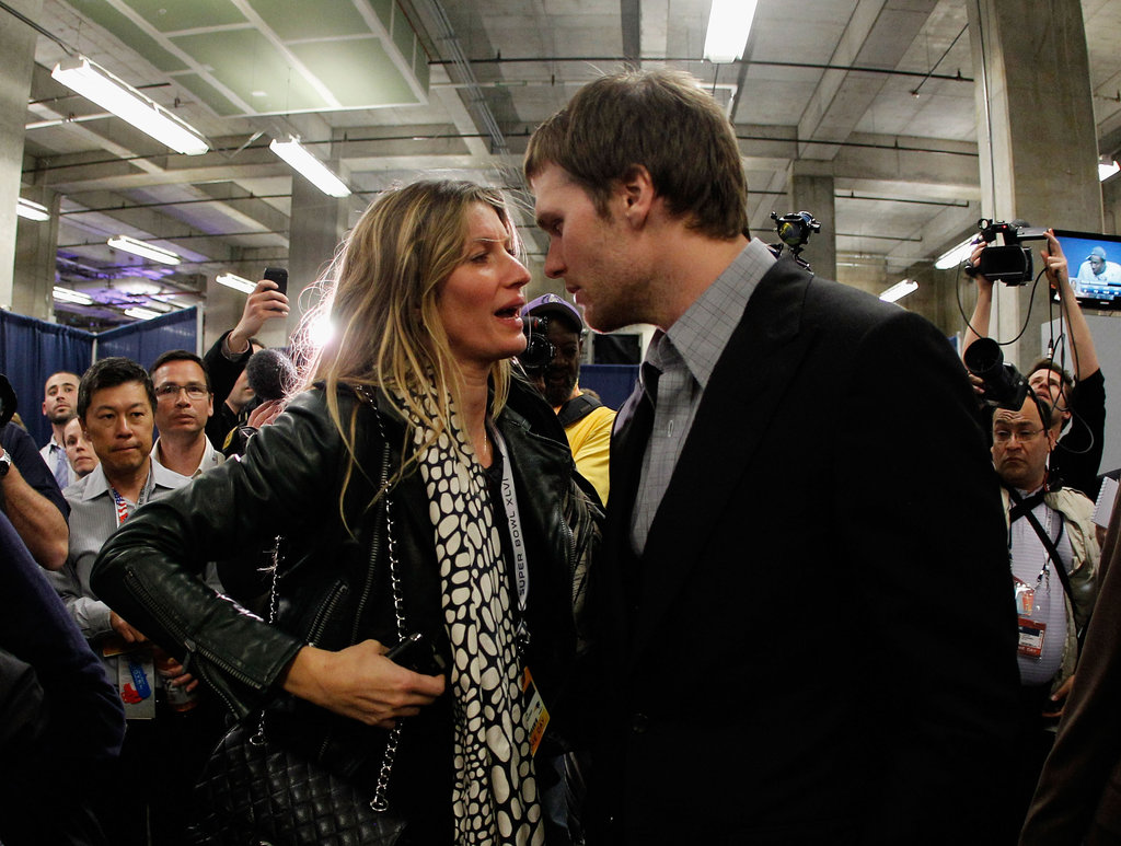 New England Patriot Tom Brady and wife Gisele Bündchen chatted after his team's loss in 2012.