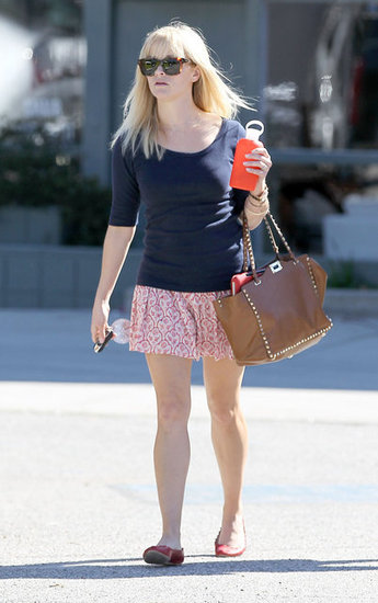 Reese Witherspoon in a navy sweater.