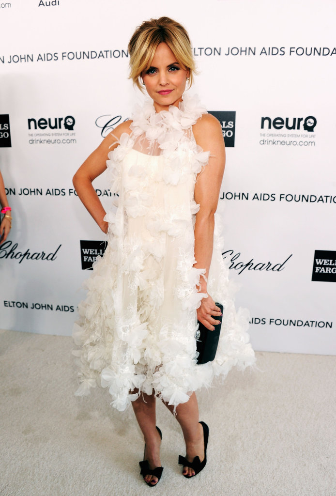 Mena Suvari was a feathery vision in white, but she contrasted the light Romona Kevezaf frock with black accessories.
