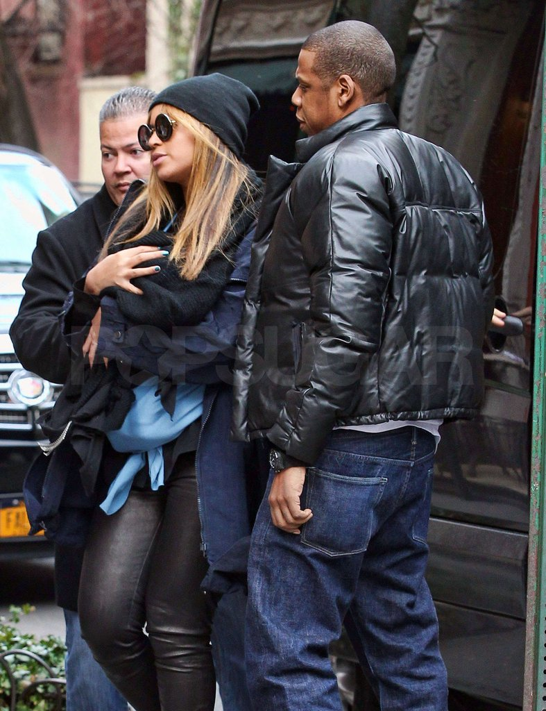 Beyoncé Knowles carried Blue Ivy Carter as her husband Jay-Z stayed close.