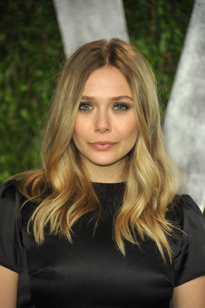 Elizabeth Olsen arrives at Vanity Fair party.