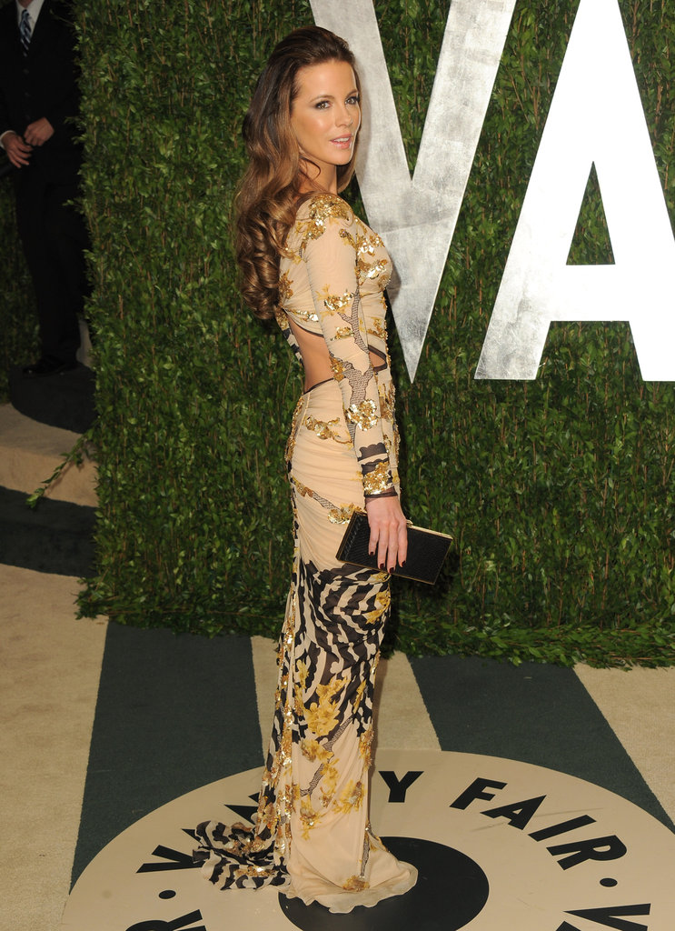 Kate Beckinsale usually sticks with solids, but last night, the actress opted for a printed body-con cut-out gown by Roberto Cavalli.