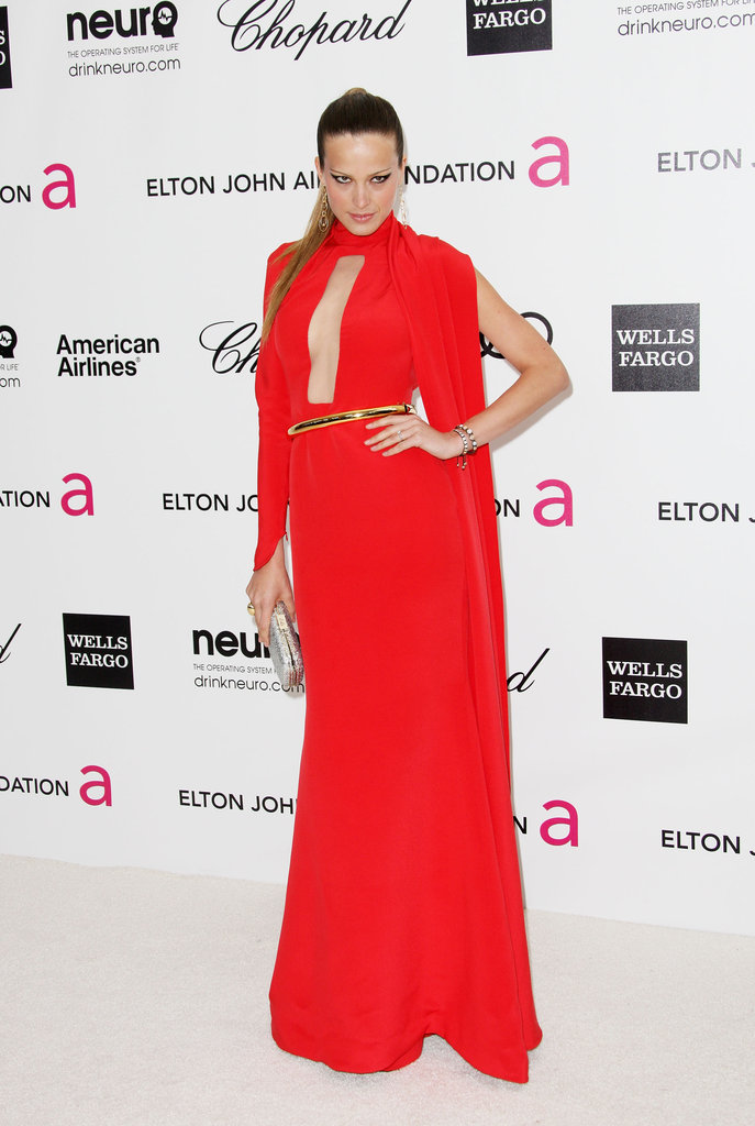Petra Nemcova chose a sultry red gown with a revealing key hole neckline.