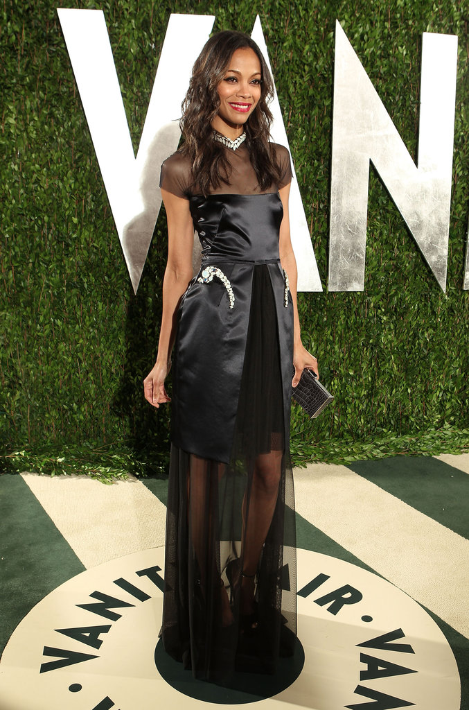 Zoe Saldana's Marios Schwab gown featured both luxe embellishment and sheer insets at the neckline and at the skirt, giving the dress a sexy twist.