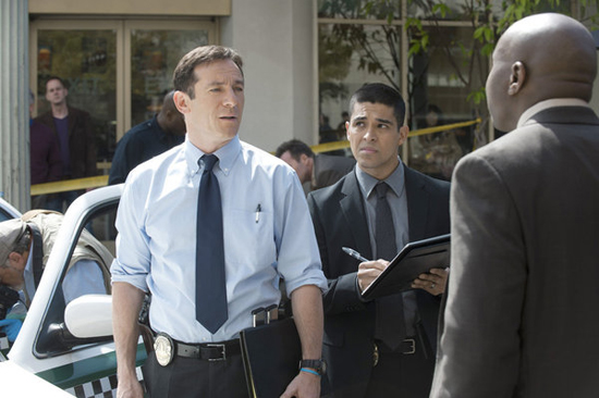 Jason Isaacs as Michael Britten, Wilmer Valderrama as Detective Efrem Vega, and Steve Harris as Detective Isaiah &quot;Bird&quot; Freeman in Awake.