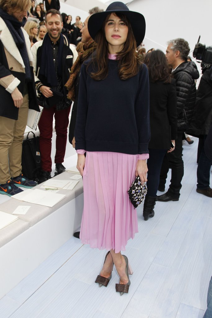 Caroline Sieber looked ultragirlie in a pink pleated skirt and bow-tie heels front row at Chloé.