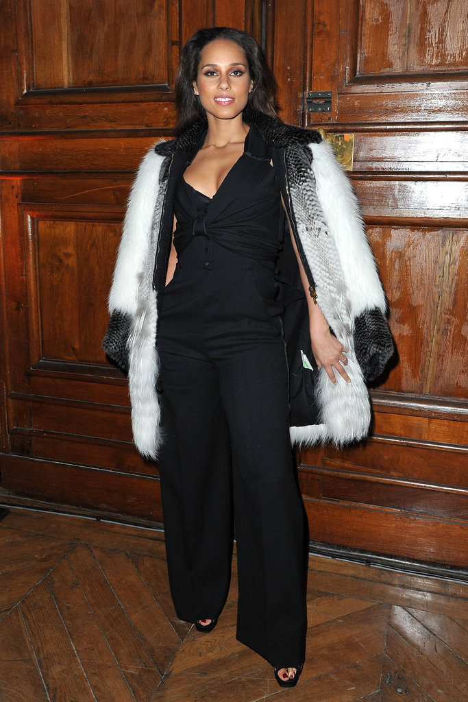 Continuing on her Paris Fashion Week takeover, Alicia Keys paired a luxe fur coat with a sleek black pantsuit for Yves-Saint Laurent.