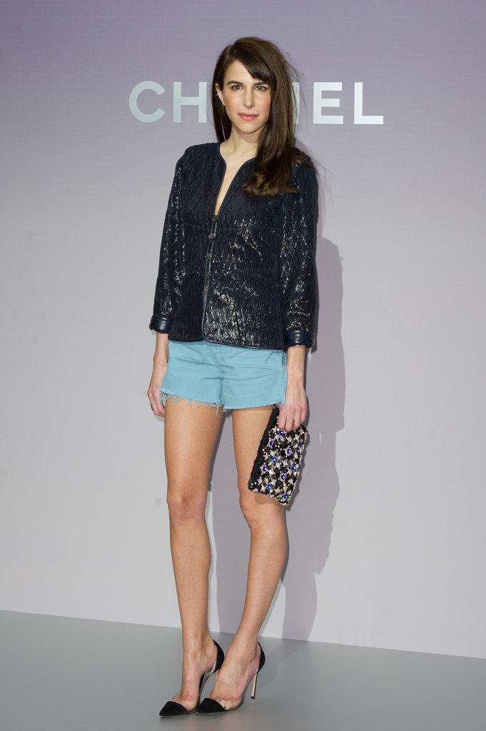 Channeling Spring's pastel power, Caroline Sieber wore baby blue shorts, a leather jacket, and a classic pair of pointy-toe pumps to Chanel.