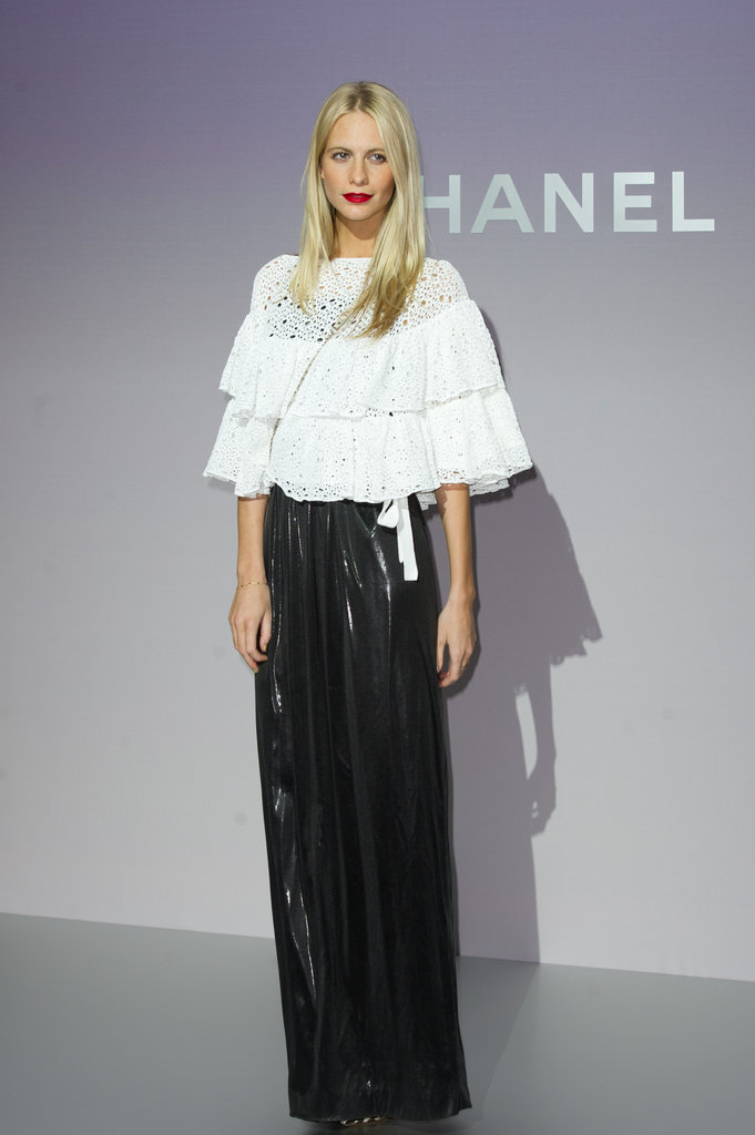 Poppy Delevigne chose a frilly white peasant top to accent her slick maxi skirt at the Chanel Fall '12 show.