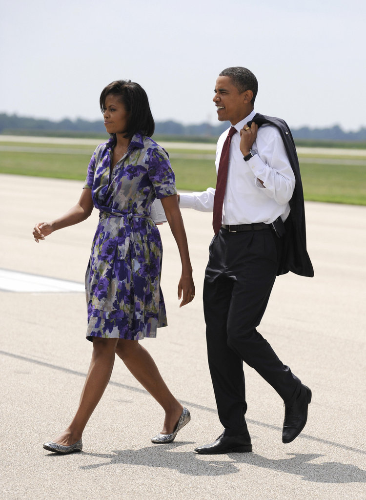 Barack kept Michelle close as they landed in Illinois in August.