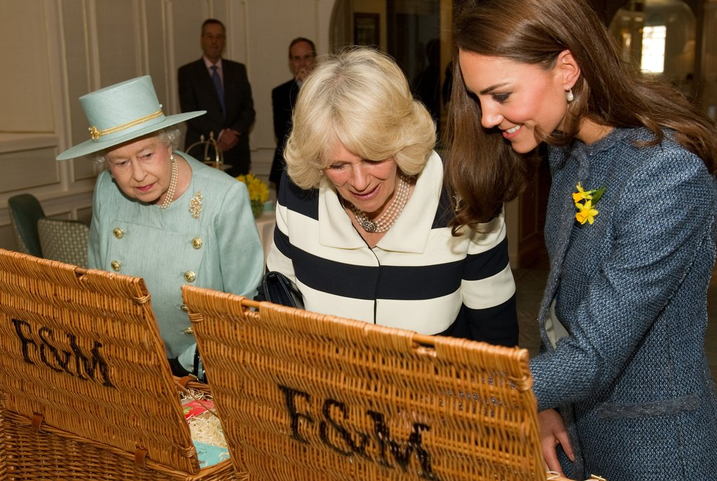 The three inspected their gifts inside Fortnum & Mason, where they were checking out products commemorating the Jubilee.