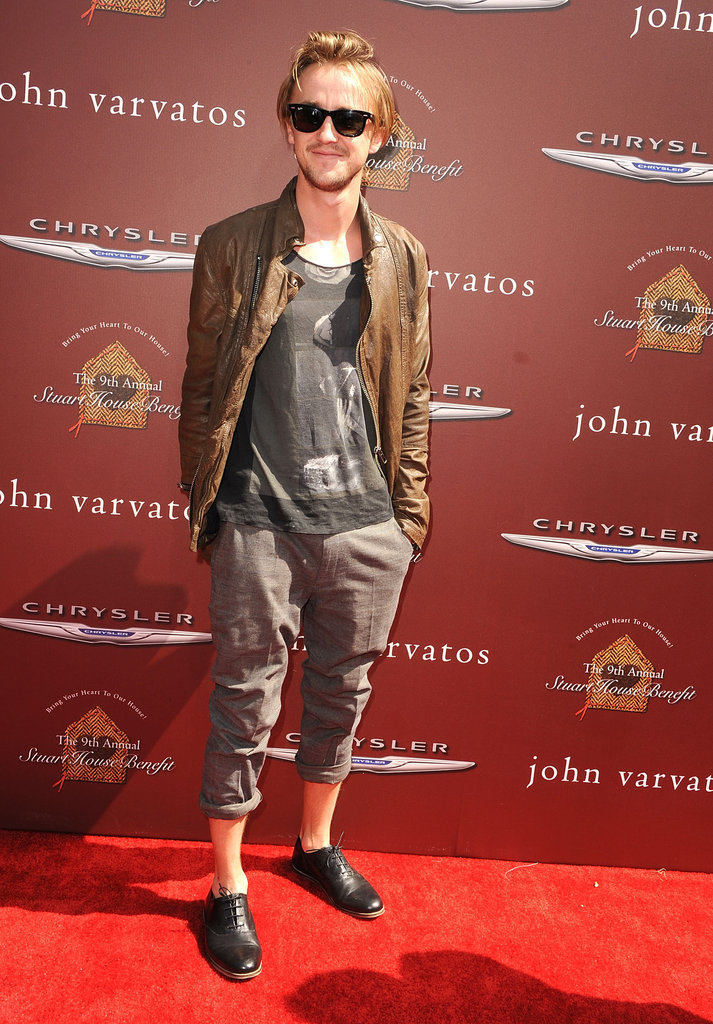 Tom Felton hit the red carpet at the John Varvatos Stuart House benefit.