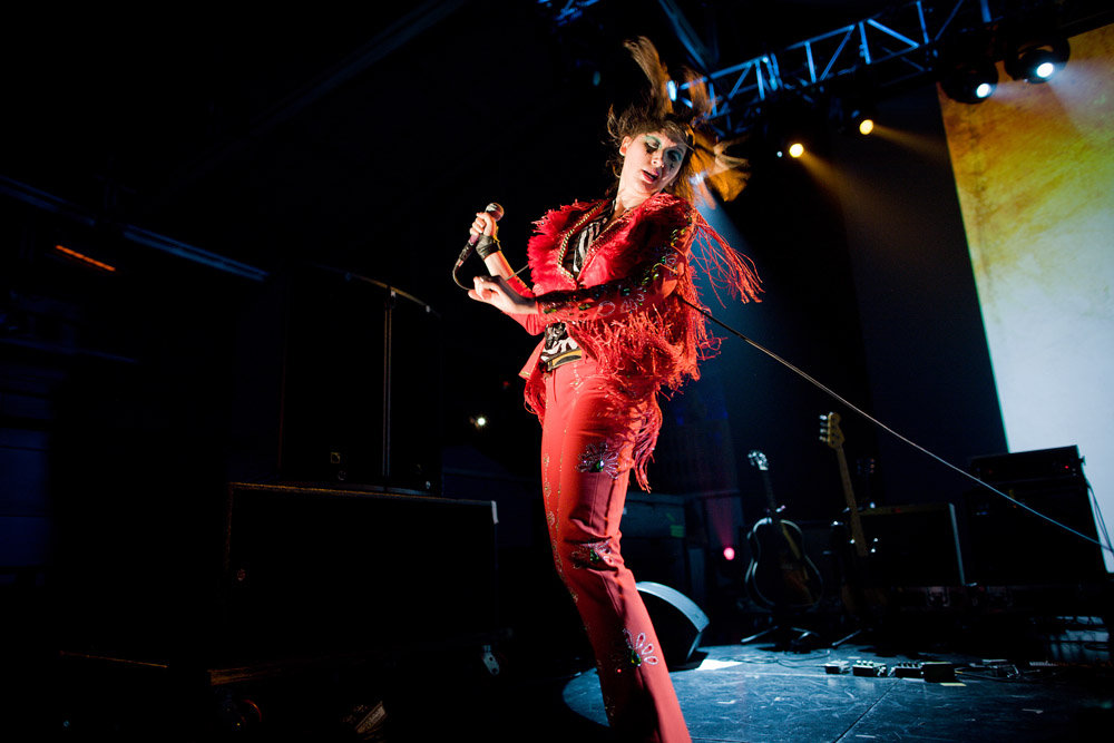 """A serious draw for the event, the Yeah Yeah Yeahs headlined the event — and Karen O's riveting red costume and spine-tingling vocals did not disappoint. The Creators Project has been working with the band, touring a photography-based installation from guitarist Nick Zinner and premiering his rock symphony, """"41 Strings,"""" as well as working with Karen O to develop the epic psycho-opera """"Stop the Virgens."""""""