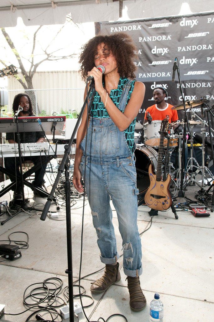 Nneka rocks a laid-back denim look that's more folksy than rocker chic. How do you feel about the resurgence of denim overalls?
