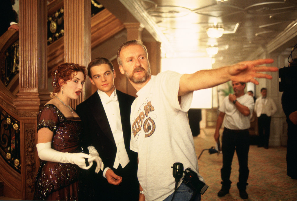 Director James Cameron, Leonardo DiCaprio, and Kate Winslet in Titanic.
