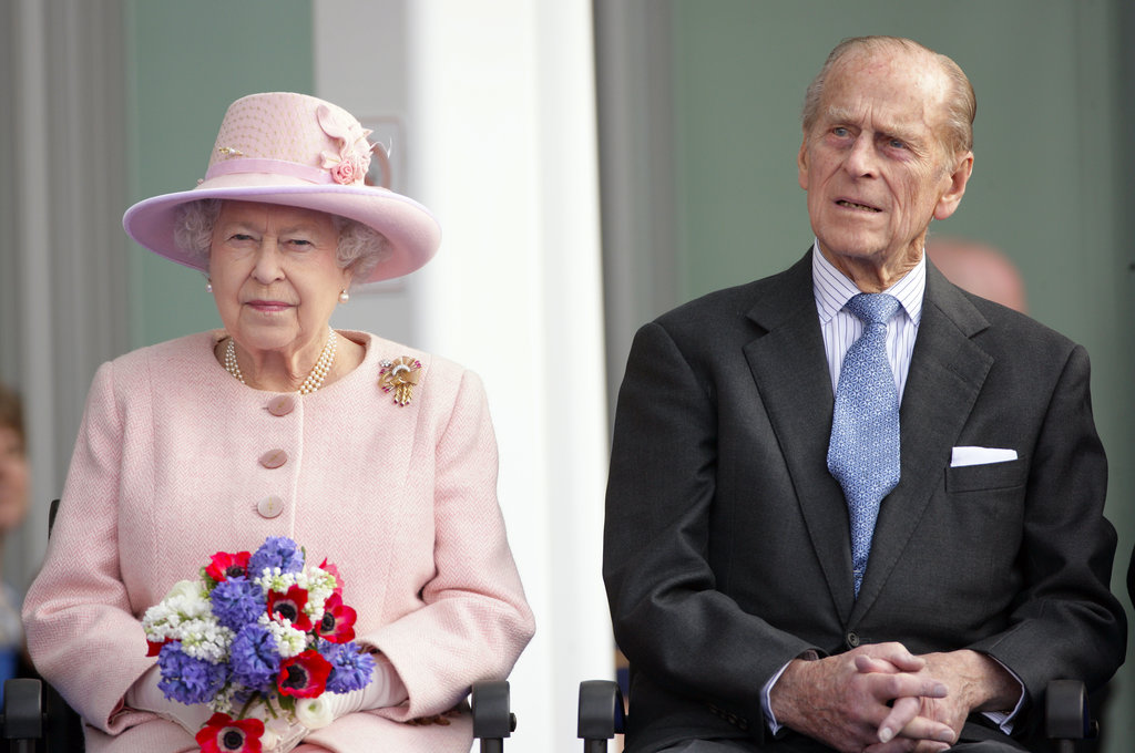 Queen Elizabeth II and Prince Philip, Duke of Edinburgh, listened to a speech as they visited St Mary's Hospital and the Manchester Royal Eye Hospital.