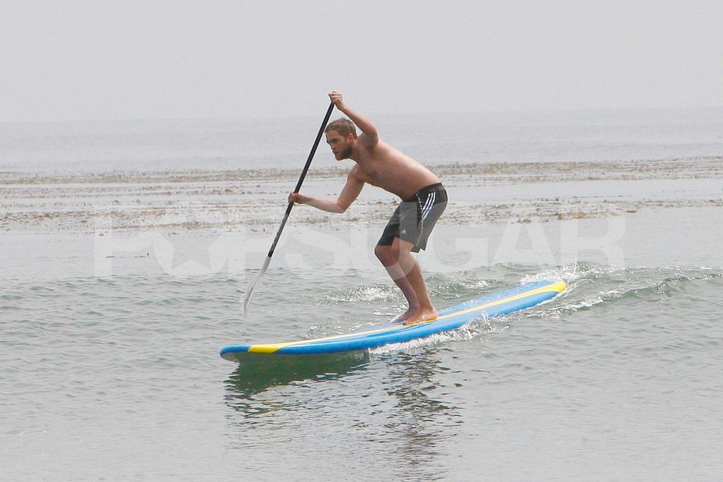 Robert Pattinson surfed with his paddleboard.