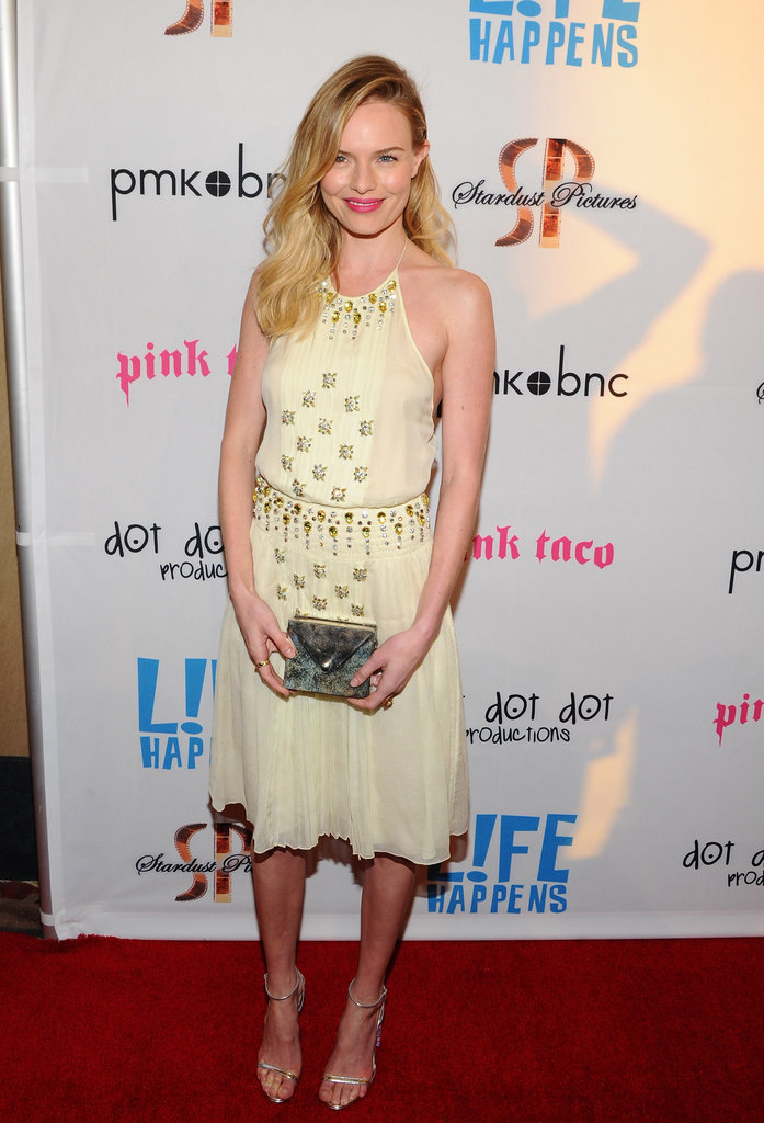 Kate Bosworth wore bright pink lips and a pale yellow dress to the premiere of Life Happens in Century City.