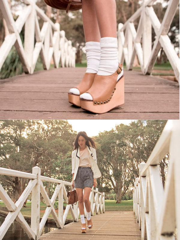 Pair a nautical-inspired white blazer with silky pyjama shorts and a quirky sock-sandal combo.   Photo courtesy of Lookbook.nu